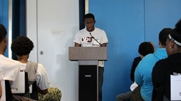 young man speaking at podium